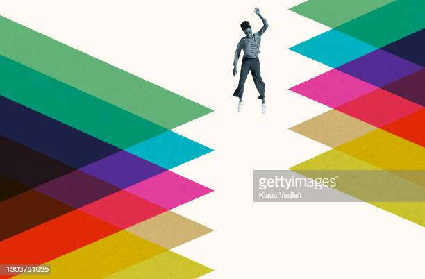 young woman falling amidst colorful pattern - exploration stock pictures, royalty-free photos & images