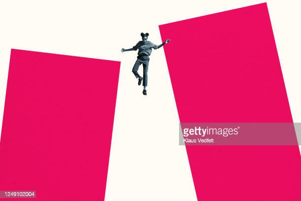 young woman falling from large pink columns - graphic accident photos stock pictures, royalty-free photos & images