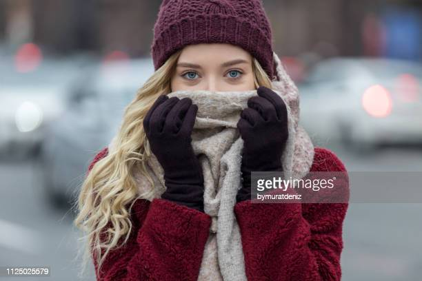 young woman feeling cold in winter - scarf stock pictures, royalty-free photos & images