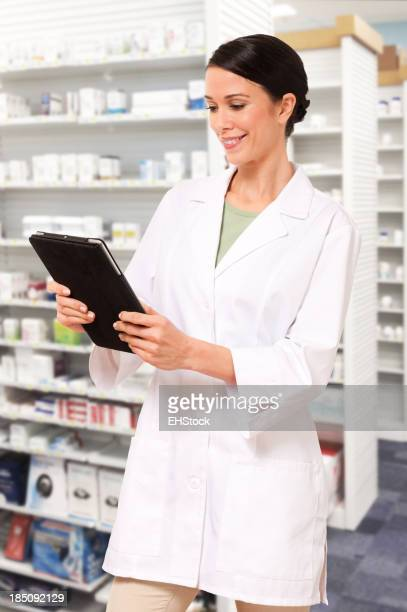 Young Woman Female Pharmacist with Digital Tablet in Pharmacy