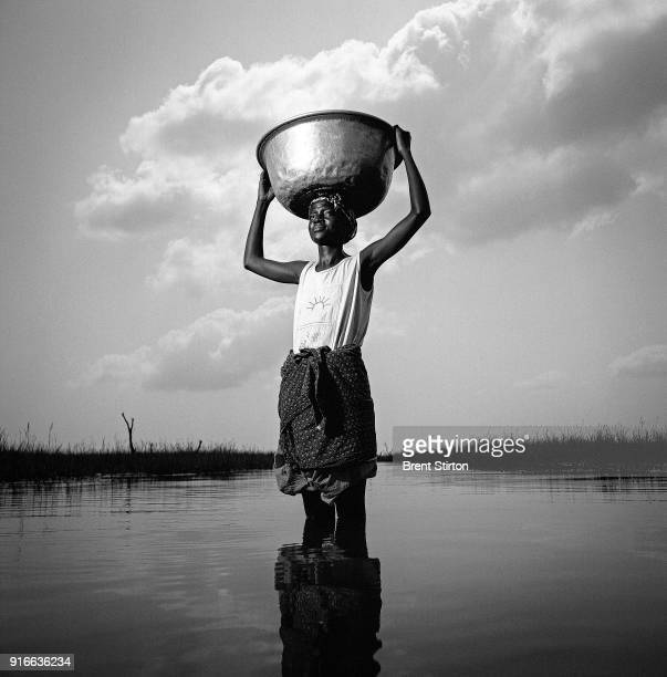 A young woman fetches water from a swamp area 4 miles from her village she makes this trip at least once a day seven days a week It takes a large...