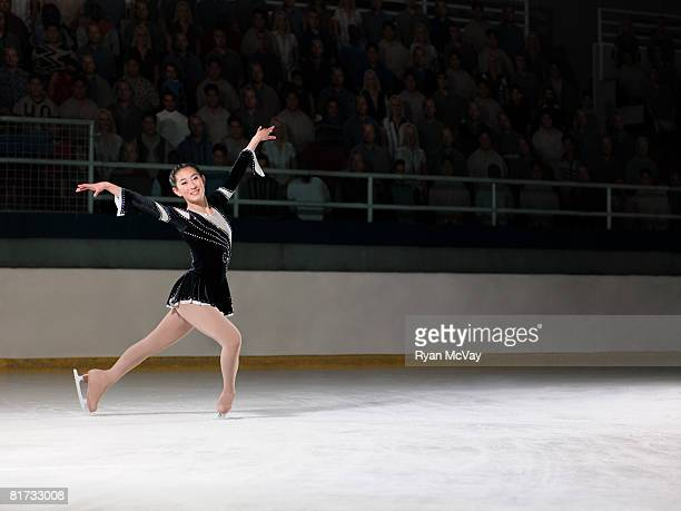 young woman figure skater standing in finishing pose. - patinage artistique photos et images de collection