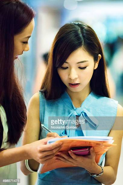 young woman filling up survey - fashion collection stock pictures, royalty-free photos & images