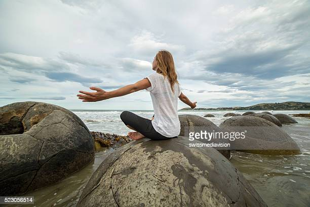Young woman finds her balance in nature