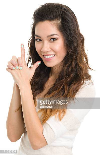 Young Woman Finger Gun Gesture