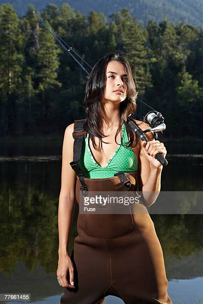 Young Woman Fishing at a Lake