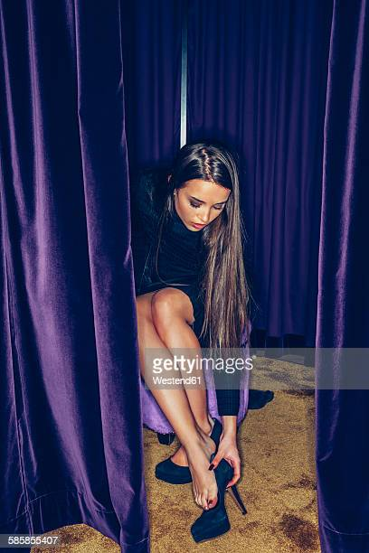 young woman fitting high heels in a clothing shop - purple shoe stock pictures, royalty-free photos & images