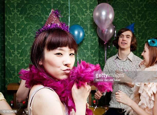 Young woman flirting at party.