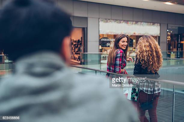 Young woman flirting in the shopping center