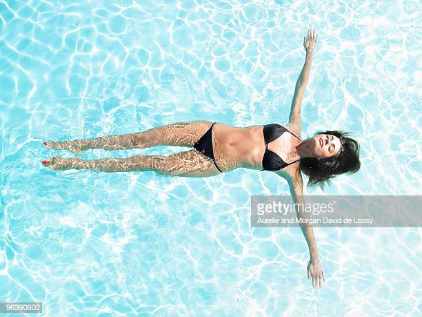 young woman floating in pool