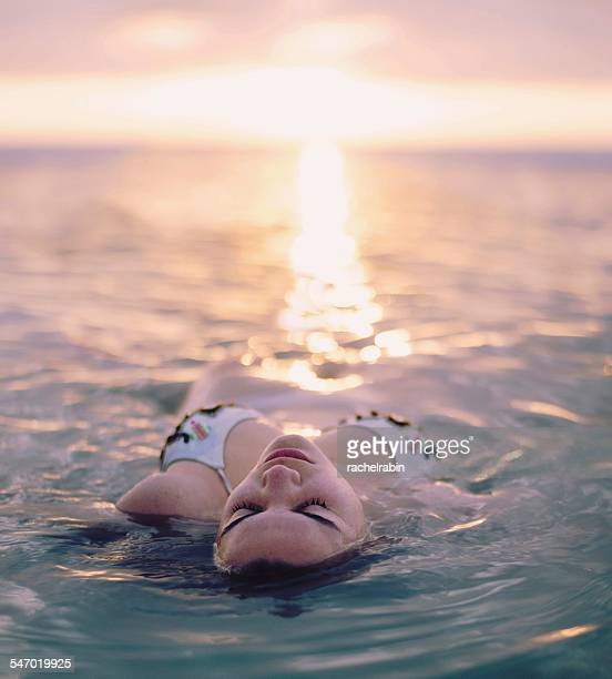 Young woman floating in the sea, Sanibel Island, Florida, USA