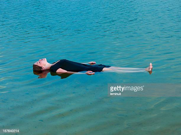 young woman floating. - dead body in water stock pictures, royalty-free photos & images