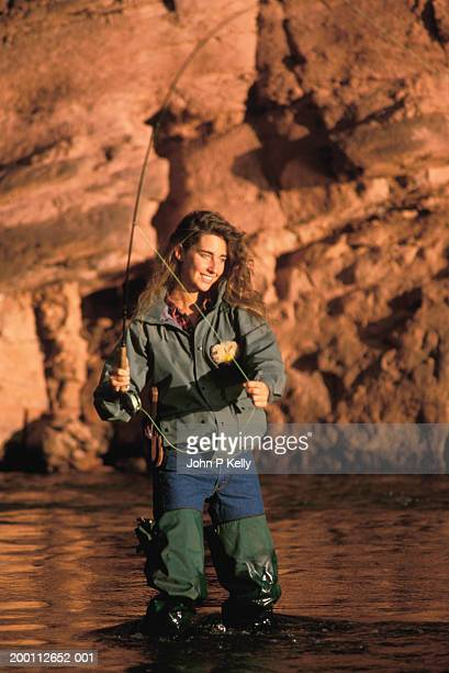 Young woman fly-fishing