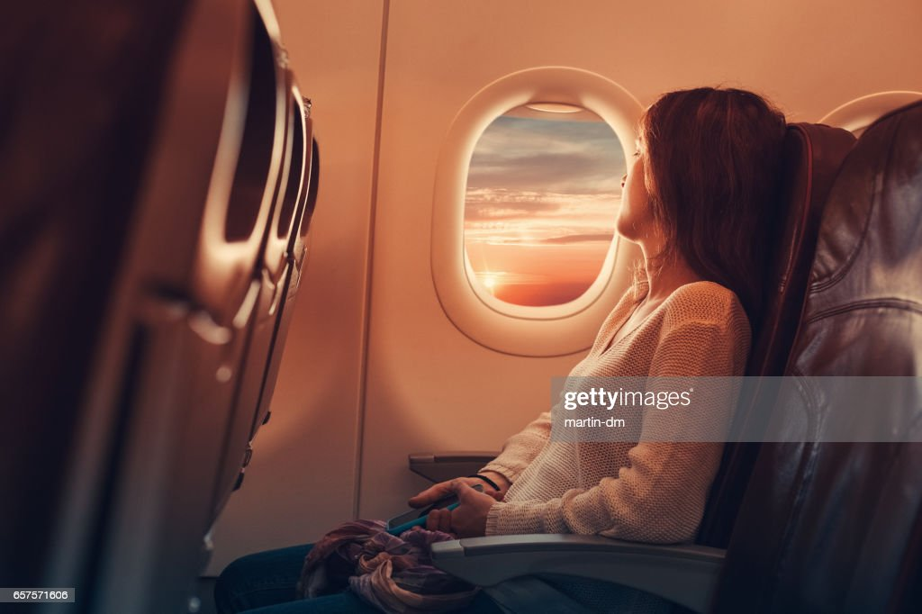 Young woman flying to France : Foto de stock