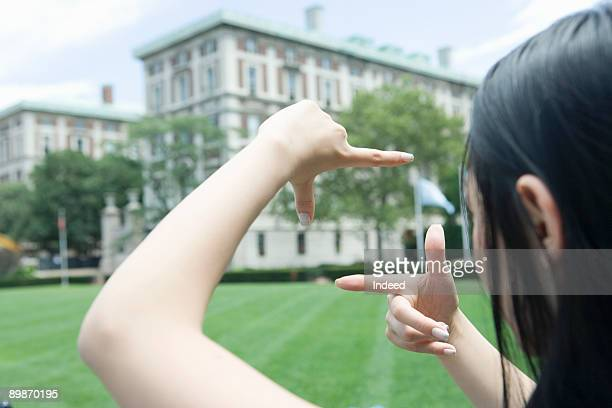 Young woman framing with her finger