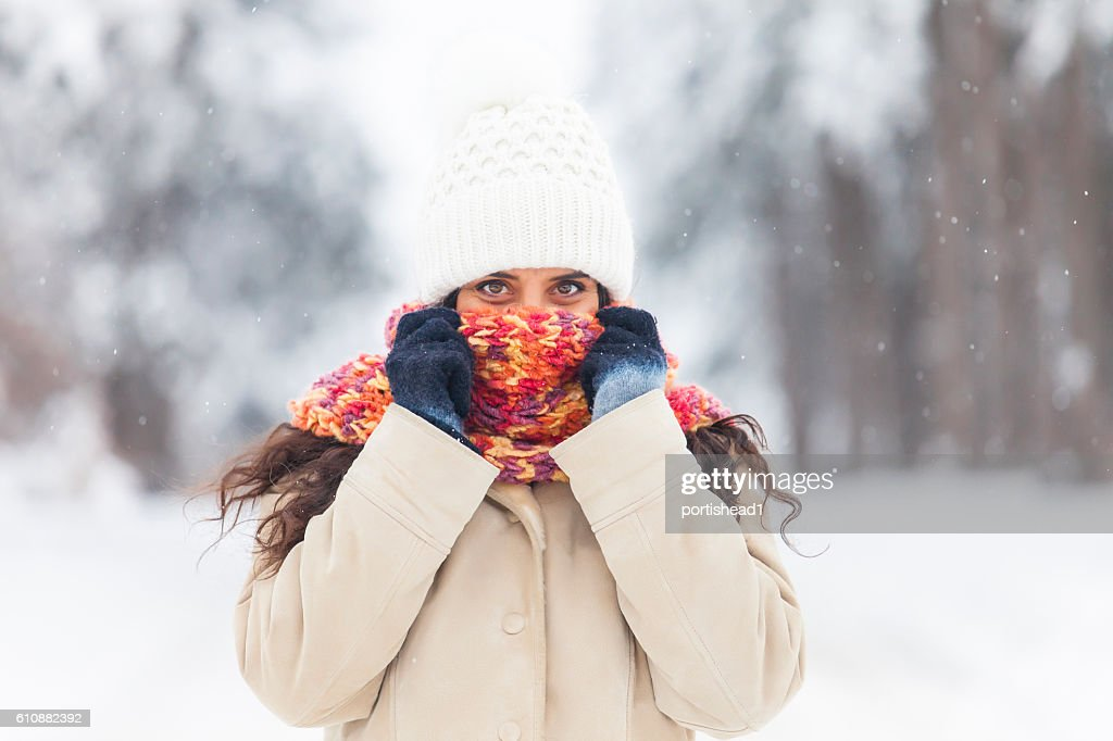 Young woman freezing fun in the snow forest : Stock Photo