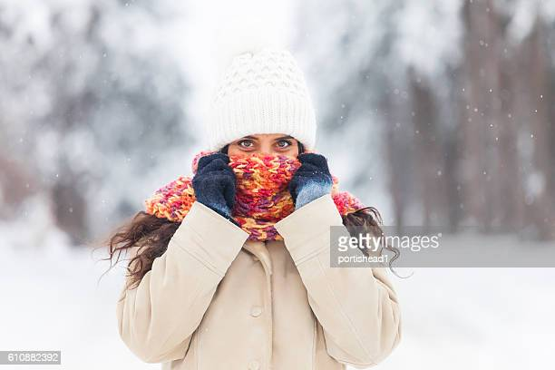 Young woman freezing fun in the snow forest