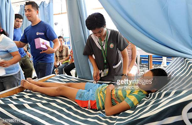 A young woman from a poor area of Manila receives free medical treatment at a special aid programme sponsored by a church in the Philippine capital...