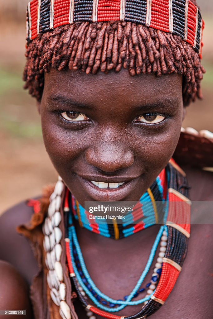 Portrait Of A Hamar Tribe Girl Holding A Calabash And