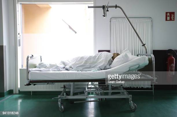 A young woman from Poland lies awaking from anesthesia after she underwent an abortion at the Krankenhaus Prenzlau hospital on April 3 2018 in...