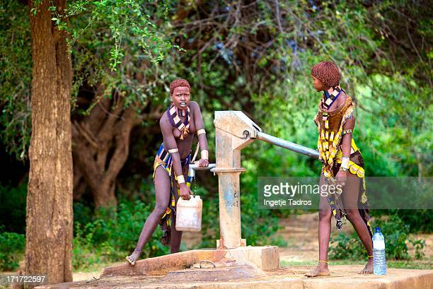 Young woman from the Hamar tribe collecting water in the Omo Valley. Ethiopia ©Ingetje Tadros