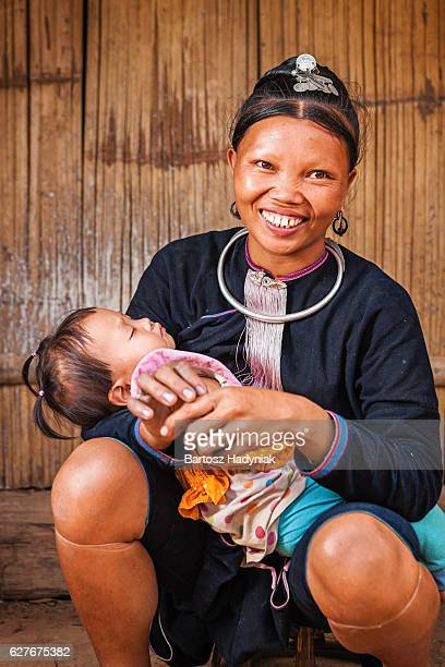 Young woman from the hill tribe holding her baby