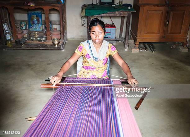 Young woman from Tripuri tribe weaving a traditional fabric, Tripuri tribe, Duluchora Para , Sreemangal , Division of Sylhet, Bangladesh, Indian...