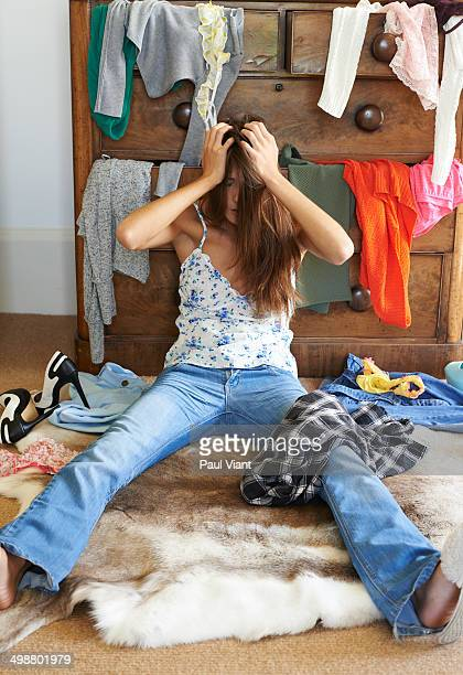 Young woman frustrated by messy bedroom