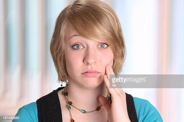 young woman gesturing toothache - open blouse stock photos and pictures
