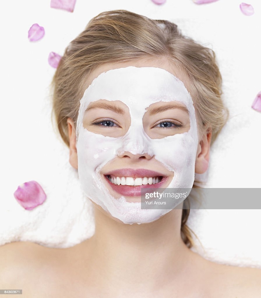 Young woman getting facial spa treatment : Stock Photo