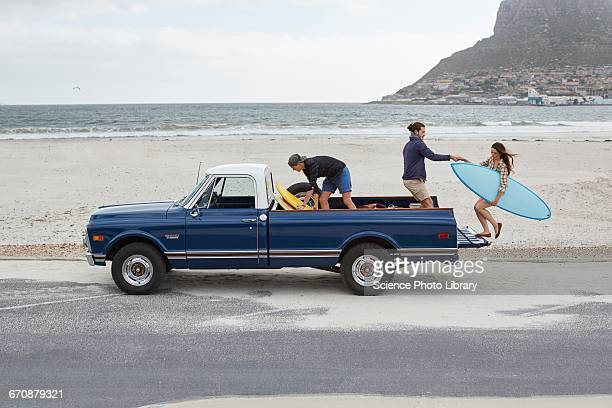 Young woman getting on to pick up truck