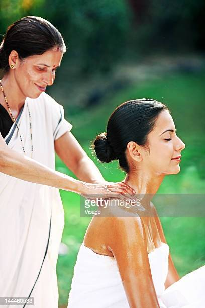 Young woman getting Pizhichil treatment