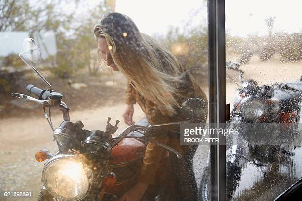 Young woman getting ready for motorcycle ride