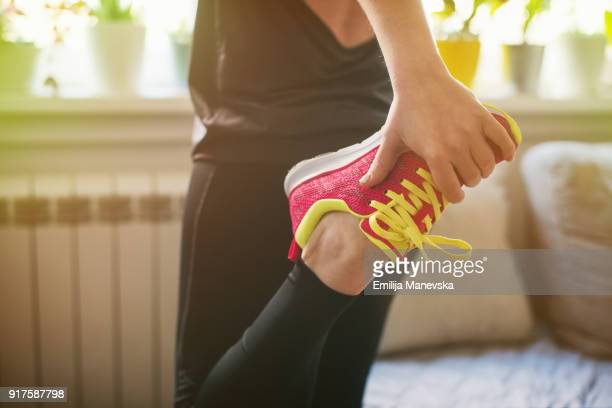 young woman getting ready for training - human limb stock pictures, royalty-free photos & images