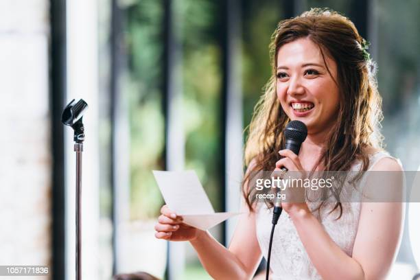 young woman giving speech - speech stock pictures, royalty-free photos & images
