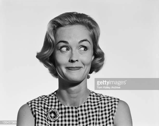 young woman glancing sideways, smiling - archive stock pictures, royalty-free photos & images