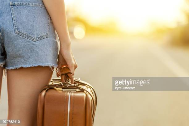young woman going on road - runaway stock pictures, royalty-free photos & images
