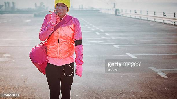 Young woman going to or from a sports training