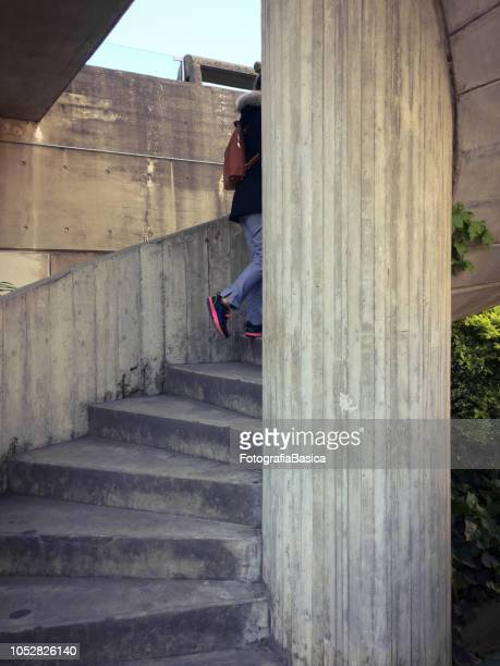 Young woman going upstairs