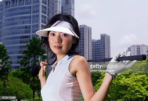 young woman golfer - 女子 ゴルフ ストックフォトと画像