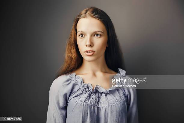 Young woman, grey background
