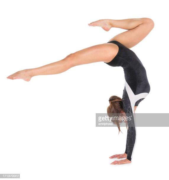 Young woman gymnast doing handstand