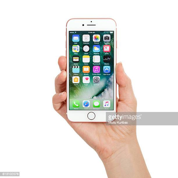 Young woman hand holding Apple iPhone 7 Rose Gold