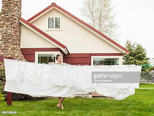 Young woman hanging the laundry outdoors