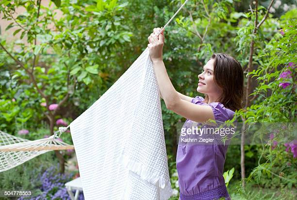 young woman hanging towel to dry
