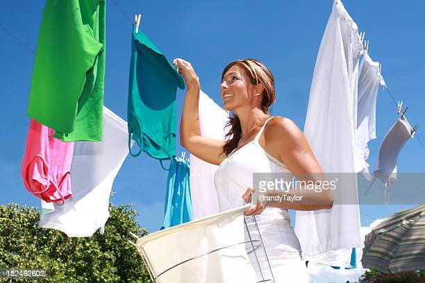 young woman hanging up laundry - clothesline stock pictures, royalty-free photos & images
