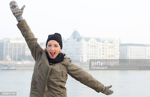 Young woman happy with extended arms