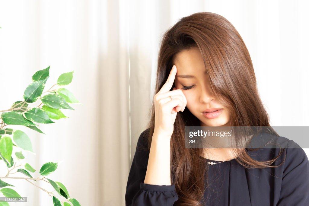 Young woman has headache : Stock Photo