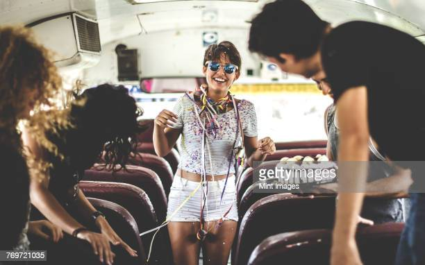 A young woman having a birthday party on a bus.