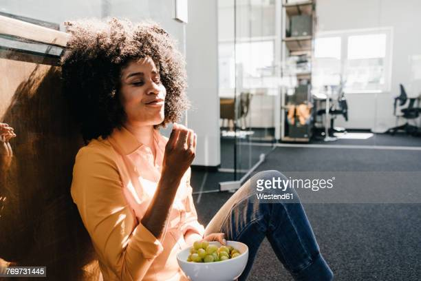 Young woman having a break in office